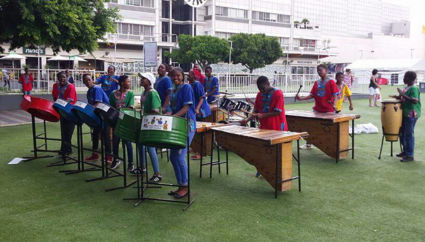 Soweto children playing music on their percussion instruments, in J'burg by Rosebank